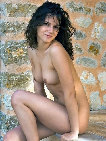 The Sweet Brunette With Tender Body Eva Femjoy Is Posing Against The Wall