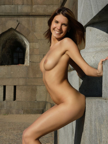 Posing Among The Stone Buildings This Smiling Chick Nata Mpl Shows Off The Nudity