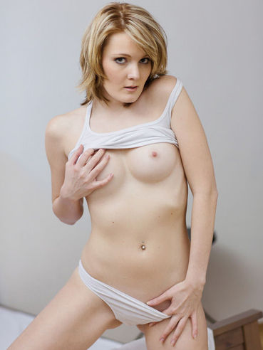 Maggies Nubiles Is A Blonde Shaved Sweetie And She Is Taking Off Her White Lingerie To Tease