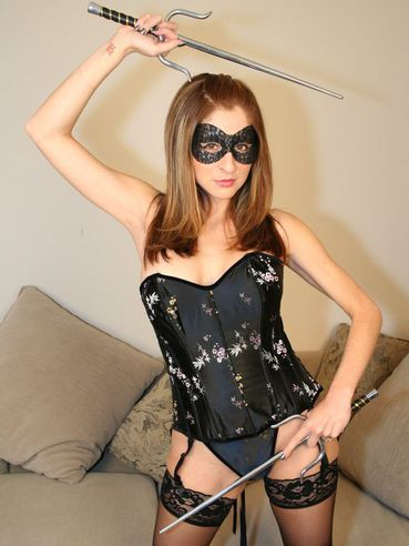 Playful Lady In Tight Black Corset Paris Kennedy Takes Off Her Mask And Nylons